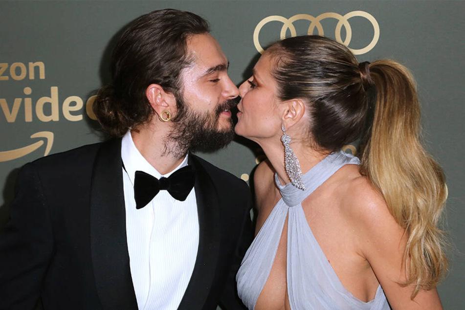 Ein Küsschen für die Kameras: Da fackeln Heidi und Tom nicht lange.