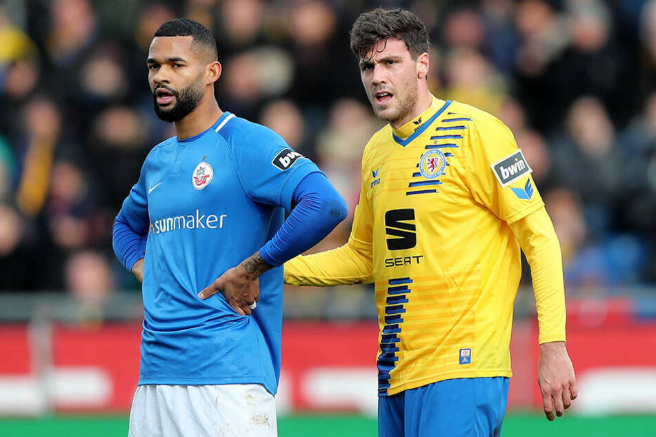 """Braunschweigs Benjamin Kessel (r.) brachte die """"Löwen"""" mit 1:0 in Führung. Hansa Rostock um Cebio Soukou hatte das Nachsehen."""