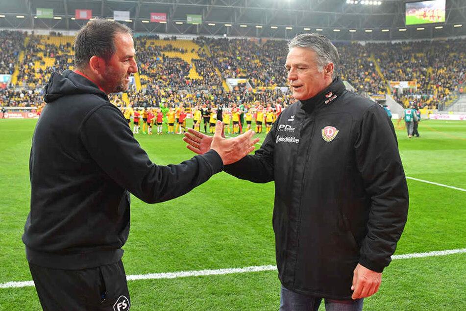 Kaum zu glauben: Dynamo-Trainer Uwe Neuhaus (r.) ist aktuell der dienstälteste Trainer eines Zweitliga-Vereins nach Heidenheim-Coach Frank Schmidt (l.).