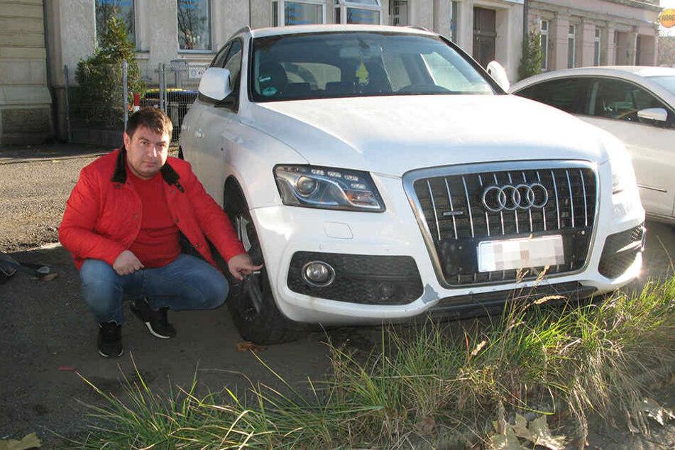 Alexander Mints (33) zeigt seinen Audi Q5. Brandstifter hatten versucht, das Auto anzuzünden.