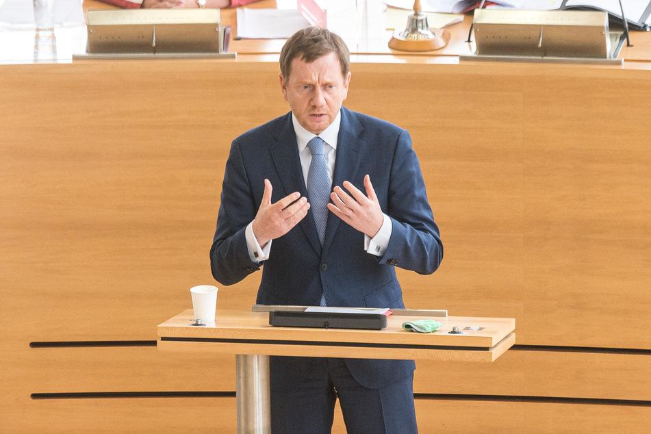 Der Herr der Lage: Michael Kretschmer (44, CDU).