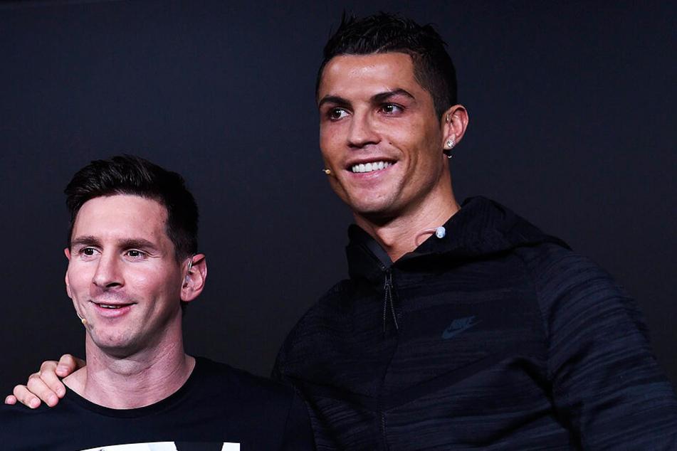 Lionel Messi (l.) und Cristiano Ronaldo bald gemeinsam in einer Mannschaft?