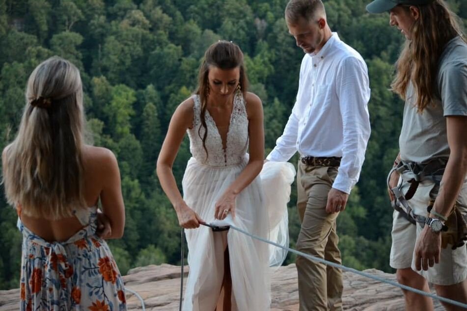 Under control: the bride was wearing a safety harness the whole time.