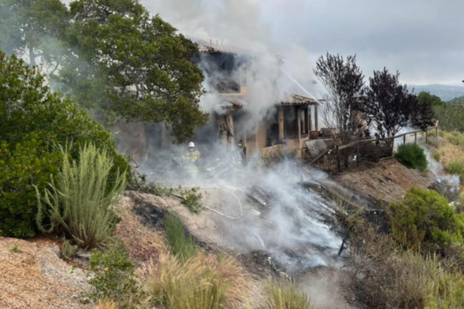 Plane crashes into California hillside home, killing everyone on board