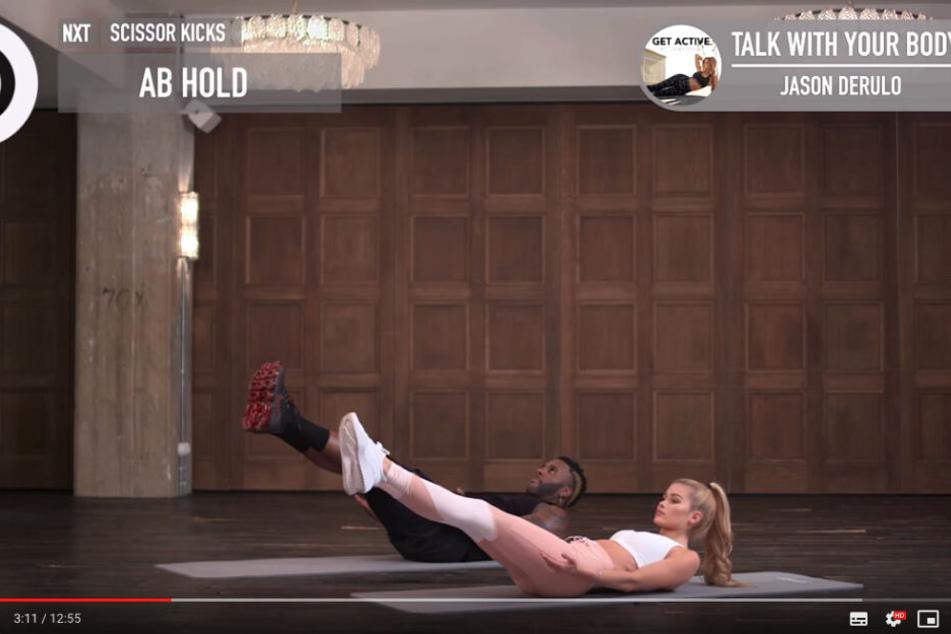 Screenshot aus dem YouTube-Video: Pamela Reif und Jason Derulo trainieren im Video.