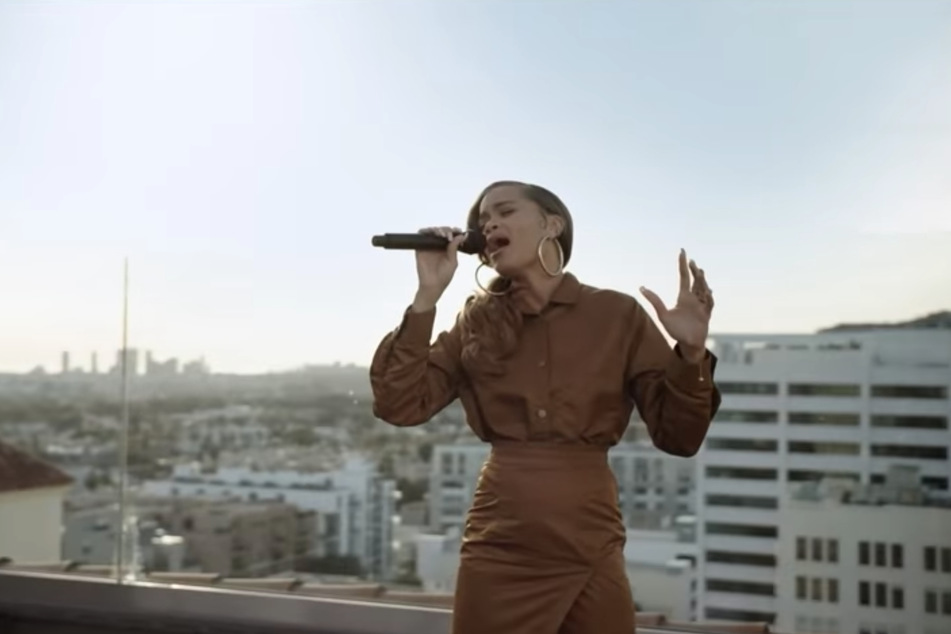 Andra Day performing her single Rise Up, in a video that also featured young ice-skater Kaitlyn Saunders.