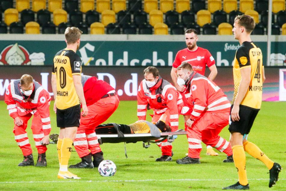 Dynamos Linksverteidiger Chris Löwe musste schon nach zwölf Minuten verletzt vom Platz getragen werden.