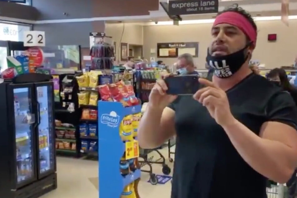 """One protester said he didn't need to wear a mask because he tested negative, and calls another shopper a """"mask Nazi."""""""