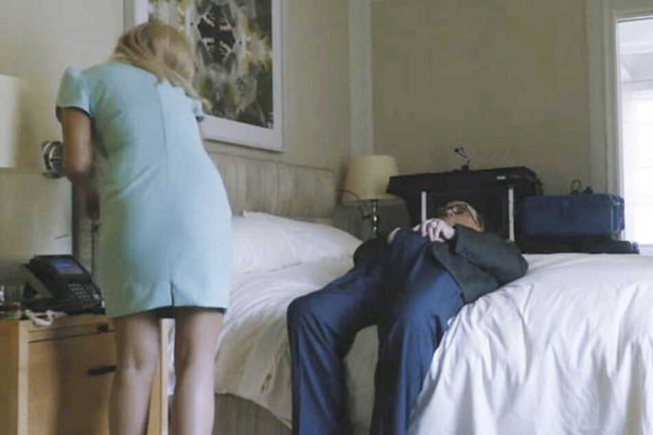 Rudy Giuliani on the bed, hand in... An embarrassing moment.
