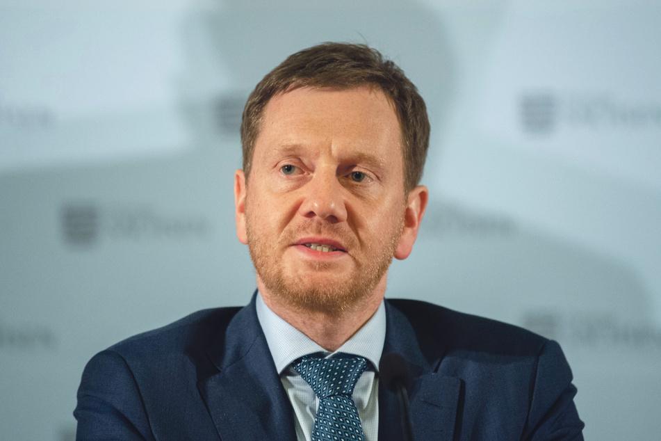 MP Michael Kretschmer (44, CDU) will im Kampf gegen Corona noch härter durchgreifen.