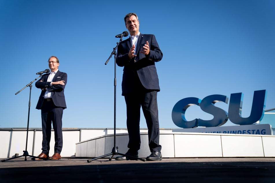 Markus Söder (r, CSU), Ministerpräsident von Bayern und CSU-Vorsitzender.
