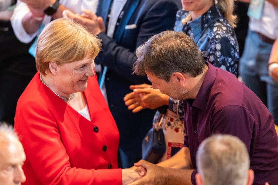 Angela Merkel mit Robert Habeck.