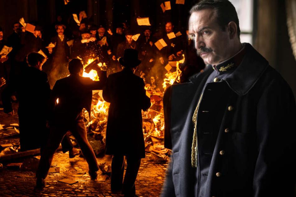Die Reaktionen auf Zolas Brief sind extrem. Einige Menschen verbrennen seine Bücher (l.). Colonel Georges Picquart (Jean Dujardin) ist ihm hingegen dankbar für die Unterstützung.