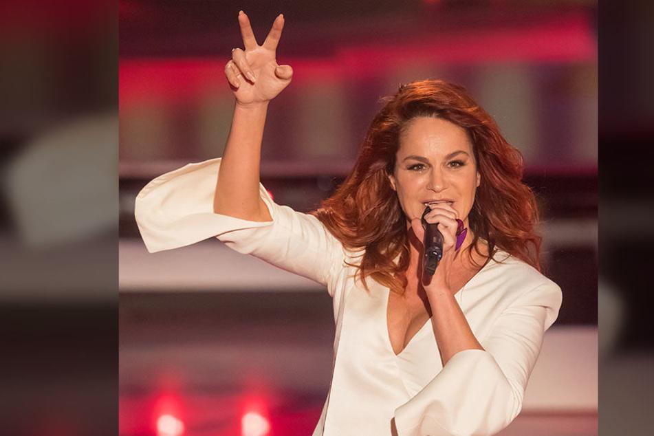 Heißer Feger auch mit 52: Schlagerstar Andrea Berg geizt auf der Bühne nicht mit ihren Reizen.