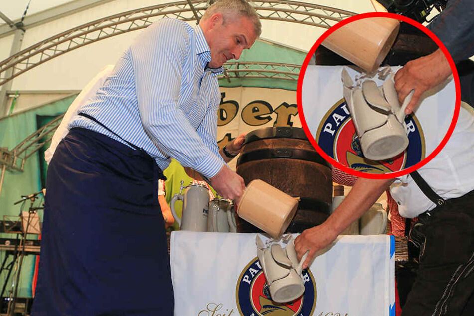 Bausewein zerlegte erstmal beim Fassbieranstich einen Bierkrug.