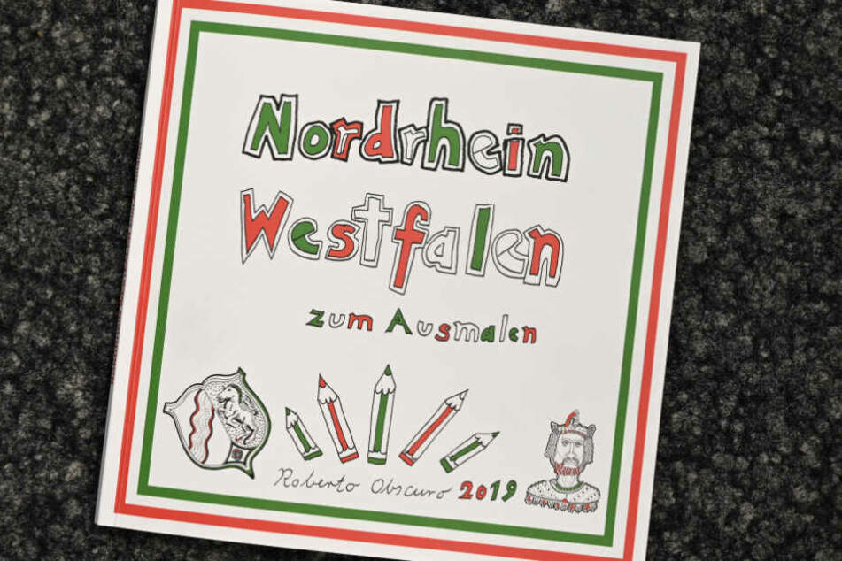 """""""Nordrhein-Westfalen zum Ausmalen"""" steht auf dem Cover des Buchs."""