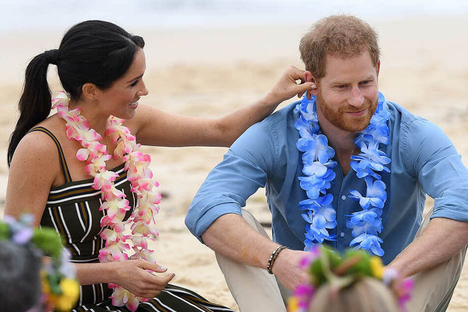Auf ihrer ersten Auslandsreise zeigten sich Harry und Meghan verliebt wie eh und je.