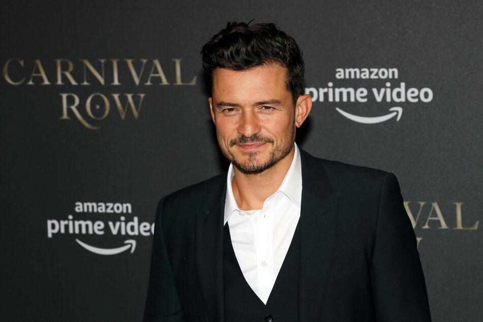 What a paw-ty! Orlando Bloom's dogs are helping him cope with his sad loss