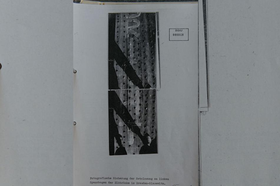 Diese Detailaufnahmen zeigen den teilweise abgewaschenen Schriftzug.