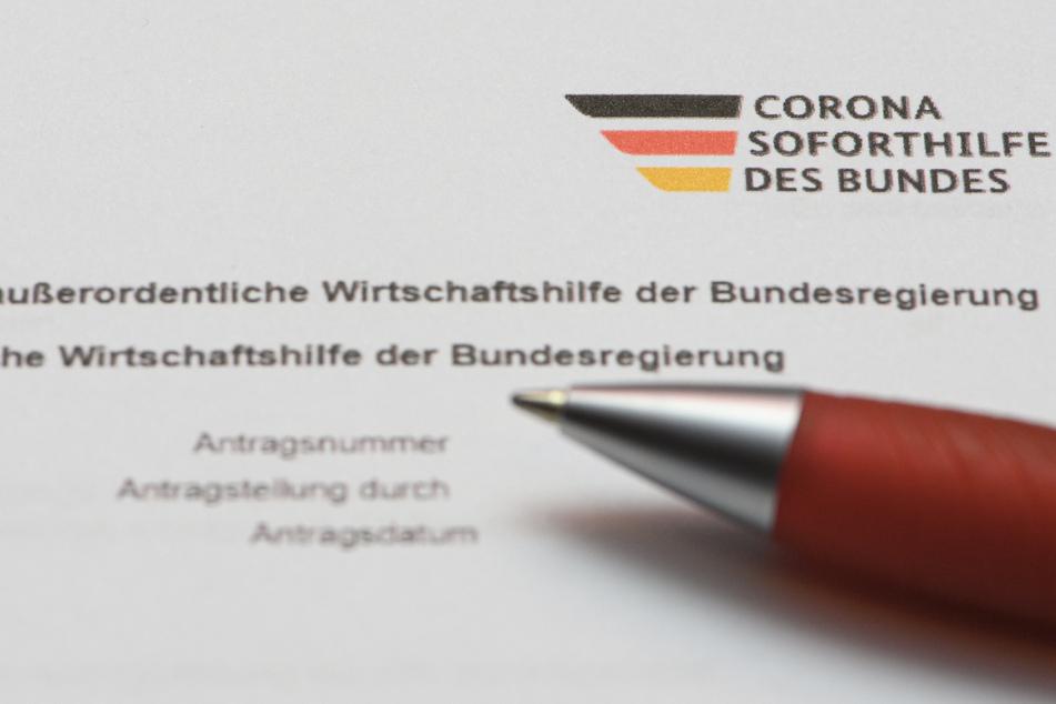 Ein Stift liegt auf einem Antrag auf Gewährung der «Novemberhilfe» als außerordentliche Wirtschaftshilfe der Bundesregierung in der Corona-Krise. (gestellte Szene)