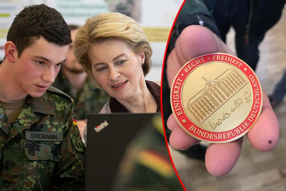 """Der Obergefreite Patrick Erdmann (19) bekam von der Ministerin die """"Commander's Coin"""" - ein persönlicher Dank."""