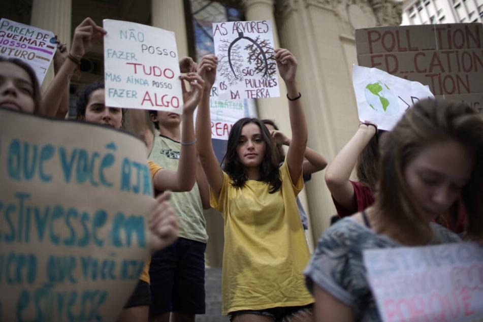 Rund um den Globus (hier in Rio de Janeiro) streiken Schüler und nehmen Sanktionen in Kauf – für ein Umdenken der Politik in der Klimapolitik.