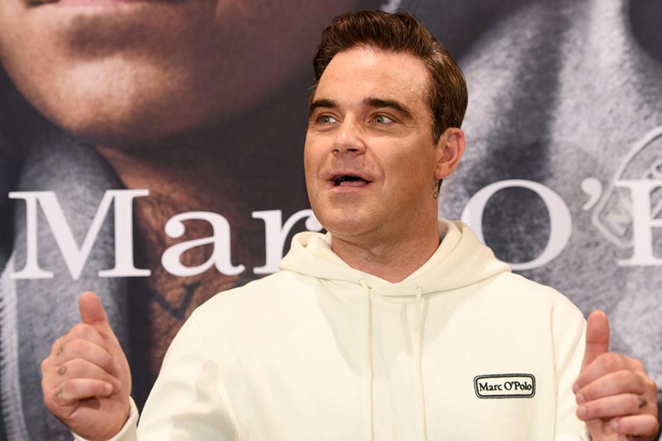 Robbie Williams (43) Sänger, Entertainer und Frauenheld?