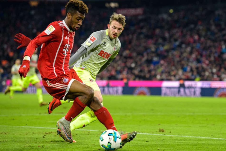 Jannes Horn vom 1. FC Köln (r., gegen Bayern Kingsley Coman) hat das Interesse von RB Leipzig geweckt.