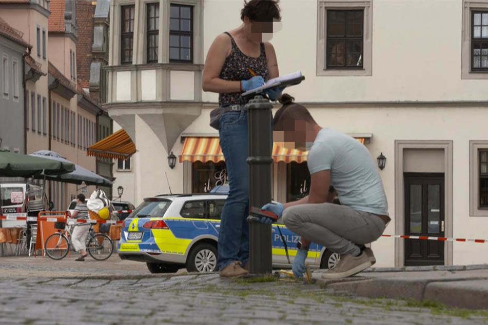 Ermittler sicherten die Spuren der möglichen Schießerei auf dem Markt.
