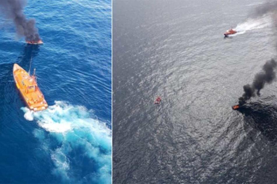 Ein Feuerwehrschiff ist im Einsatz, um das brennende Boot zu löschen.