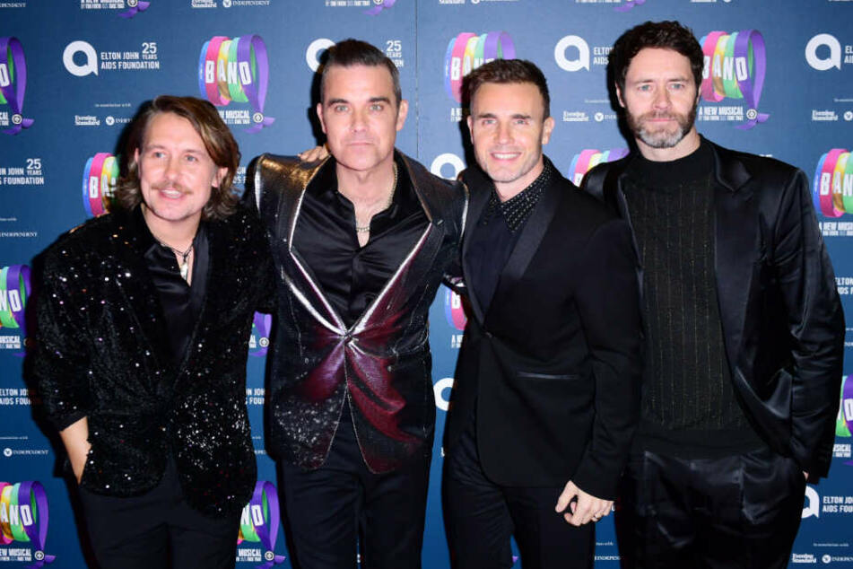 Robbie Williams und seine Bandkollegen von Take That.