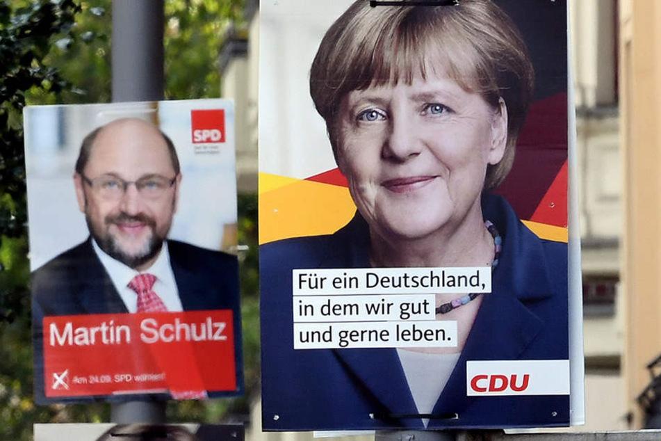 Wahlplakate für die Bundestagswahl mit den Spitzenkandidaten hängen in Berlin und buhlen mit ihrer Botschaft um die Gunst der Wähler.