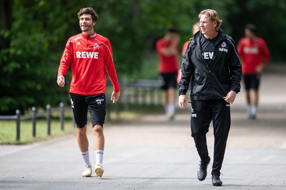 Kapitän Jonas Hector (30) und Trainer Markus Gisdol (50) gehen zum Trainingsplatz (Archivbild).