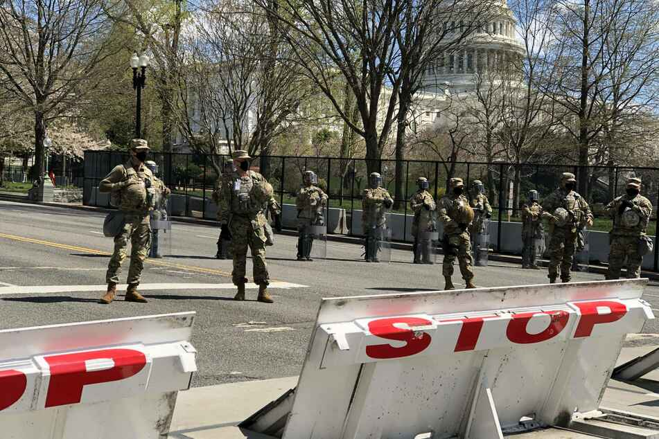 National Guard members stand guard in front of the U.S. Capitol building in Washington DC after the attack.