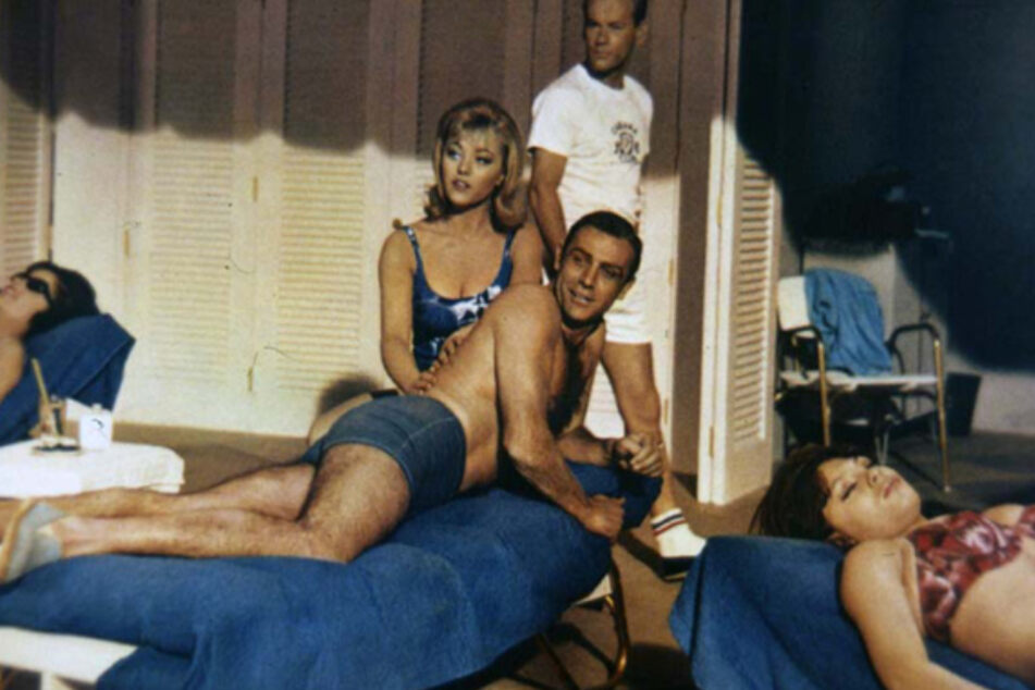 Margaret Nolan and Sean Connery (m) n the film James Bond 007 - Goldfinger.