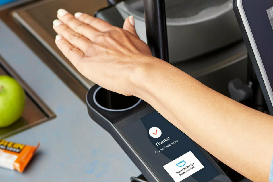 Users register by scanning their palm and connecting it to a credit card or Amazon account, then scanning their palm again to pay.