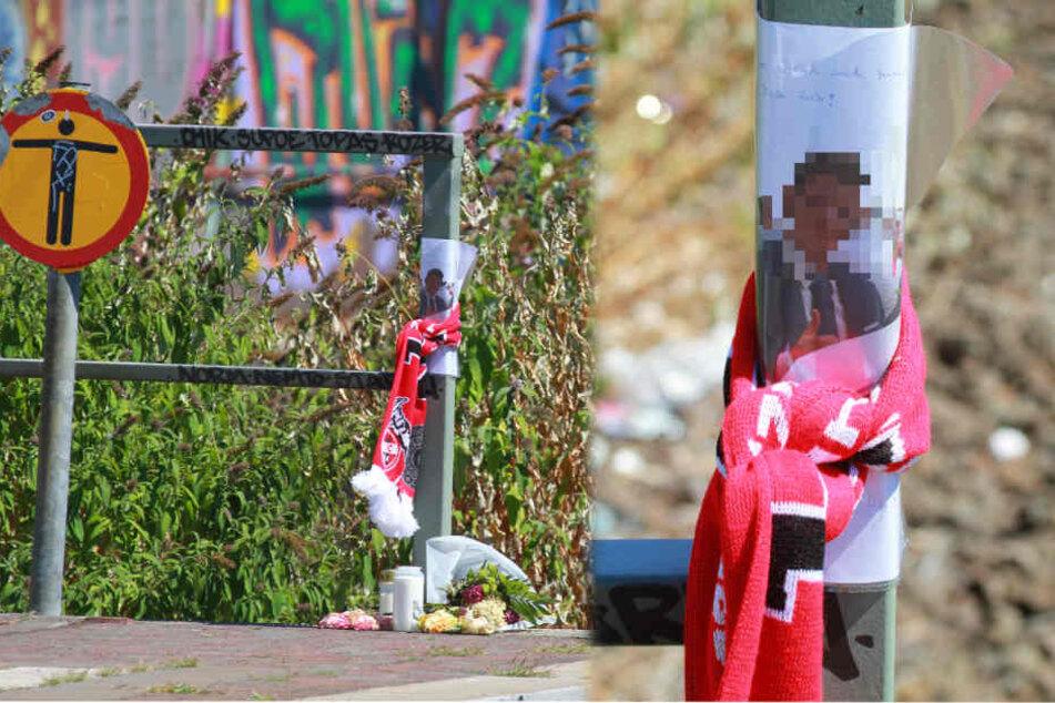 Die Angehörigen der Opfer haben an der Unfallstelle Blumen, Kerzen und Gendenkfotos niedergelegt.