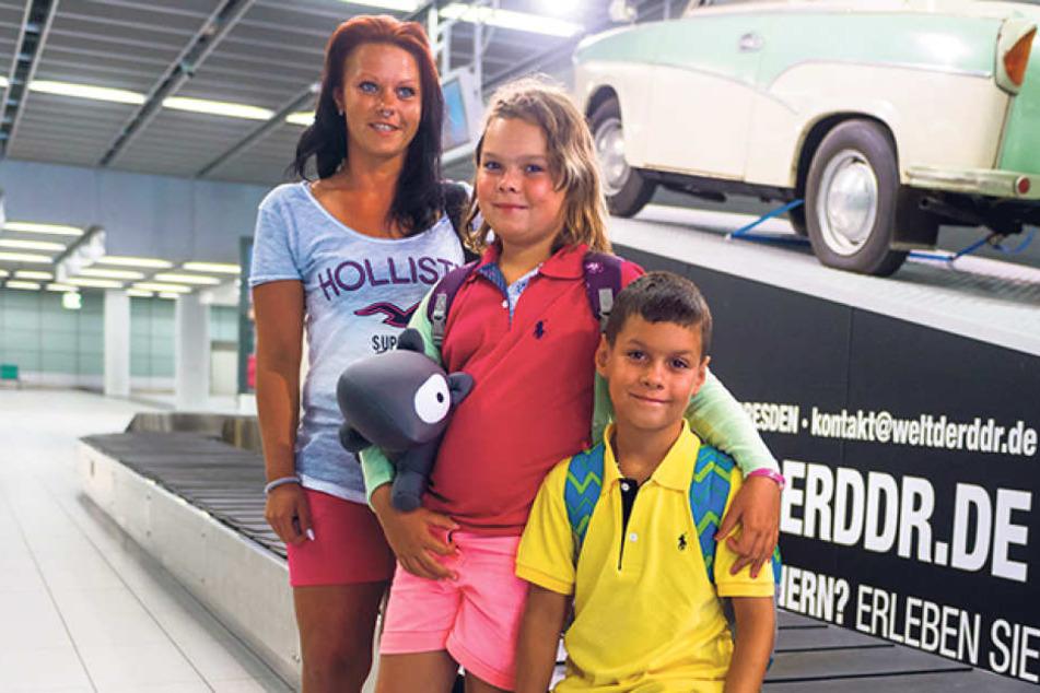 Die Dresdnerin Julia Drobisch (30) mit ihren Kindern Melina (8) und  Maximilian (7).