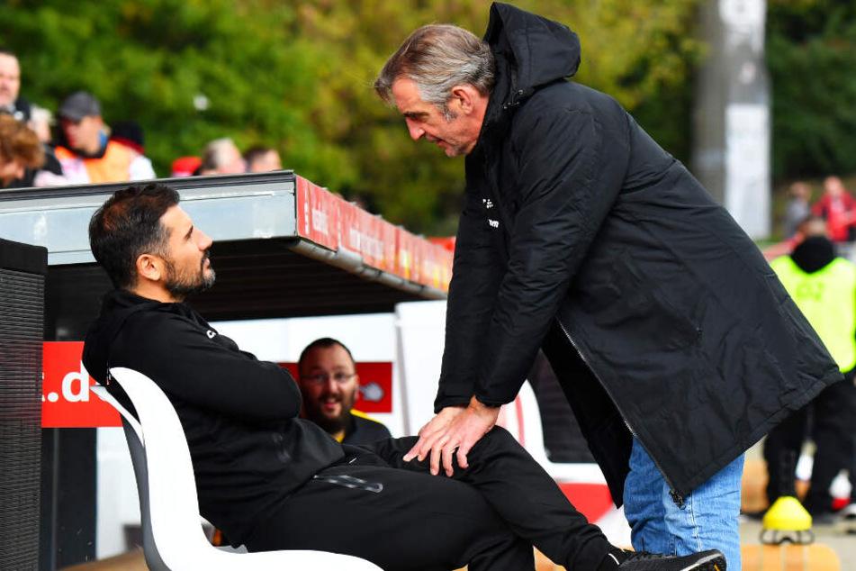Dynamo-Sportdirektor Ralf Minge (r.) hat sein eigenes (berufliches) Schicksal an das von Trainer Cristian Fiel geknüpft.