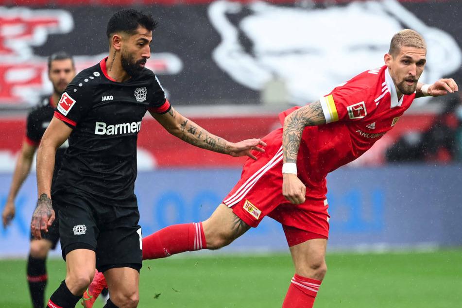 Leverkusens Kerem Demirbay (27, l.) im Zweikampf mit Unions Robert Andrich (26). Sind die beiden vielleicht bald Mannschaftskameraden?