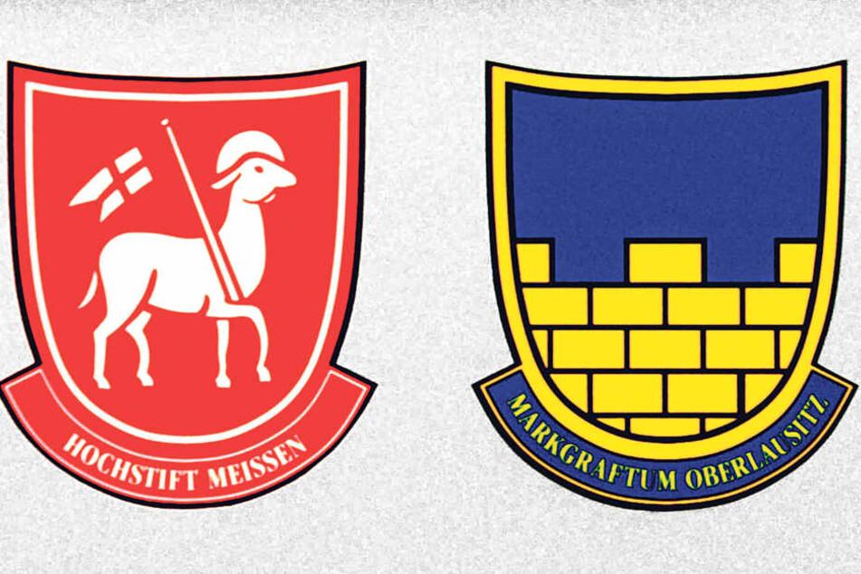 Die Grenzpfähle tragen die Wappen des Bistums Meißen und der Markgrafschaft  Oberlausitz.