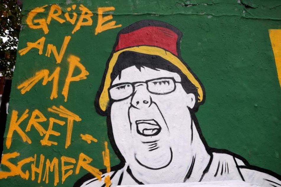 Im Graffito grüßt der Künstler Ministerpräsident Michael Kretschmer.