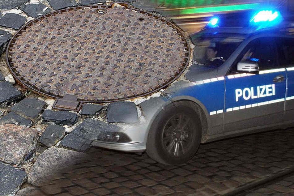 Die flüchtigen Verbrecher schlugen das Schaufenster mit einem Gullideckel ein. (Symbolbild)