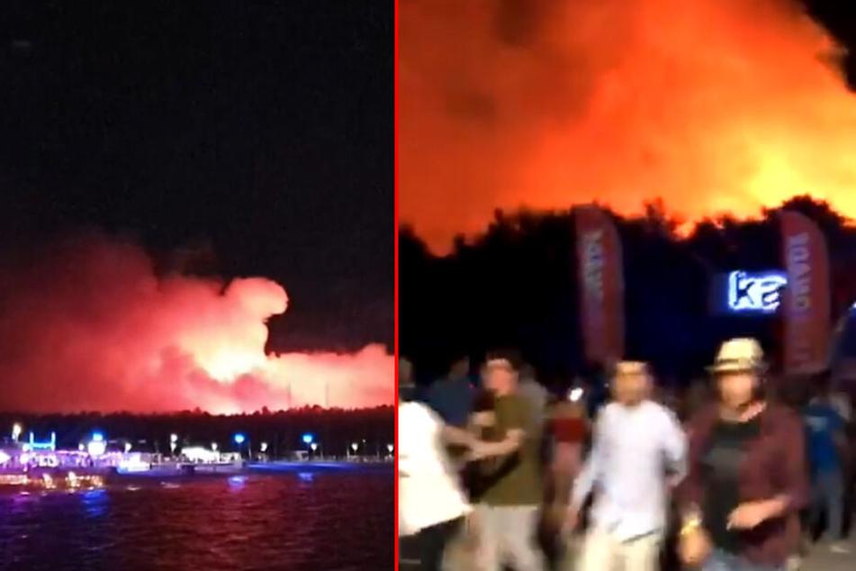 Riesiges Feuer lodert neben Festival: 10.000 Partygäste in Sicherheit gebracht!
