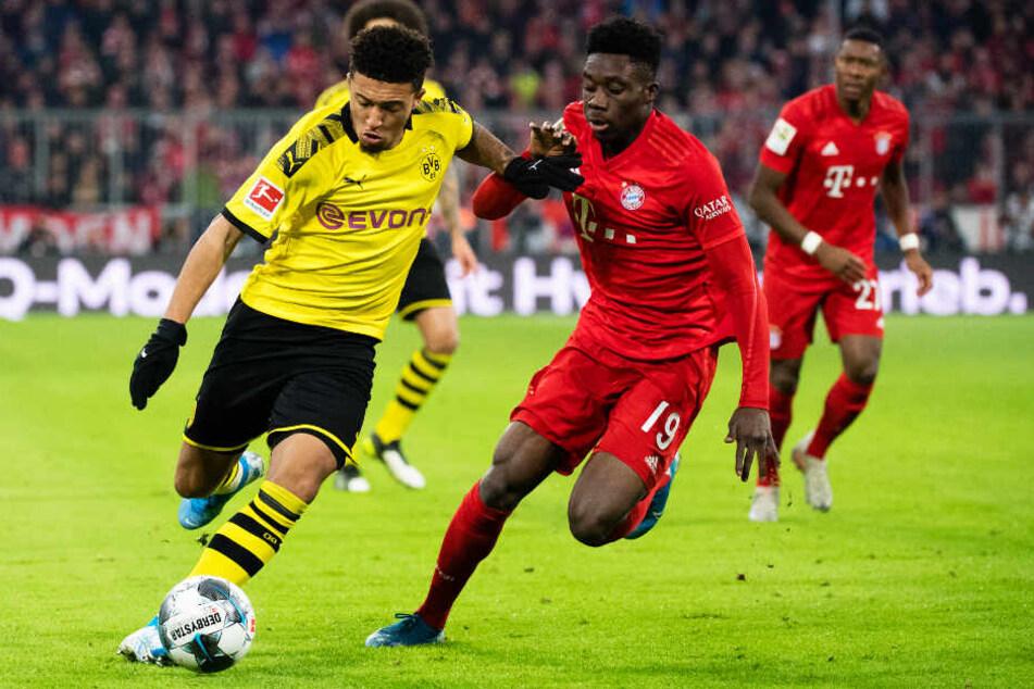 BVB-Dribbler Jadon Sancho (l.) sollte Bayern-Youngster Alphonso Davies defensiv vor Probleme stellen - doch es lief genau andersherum!