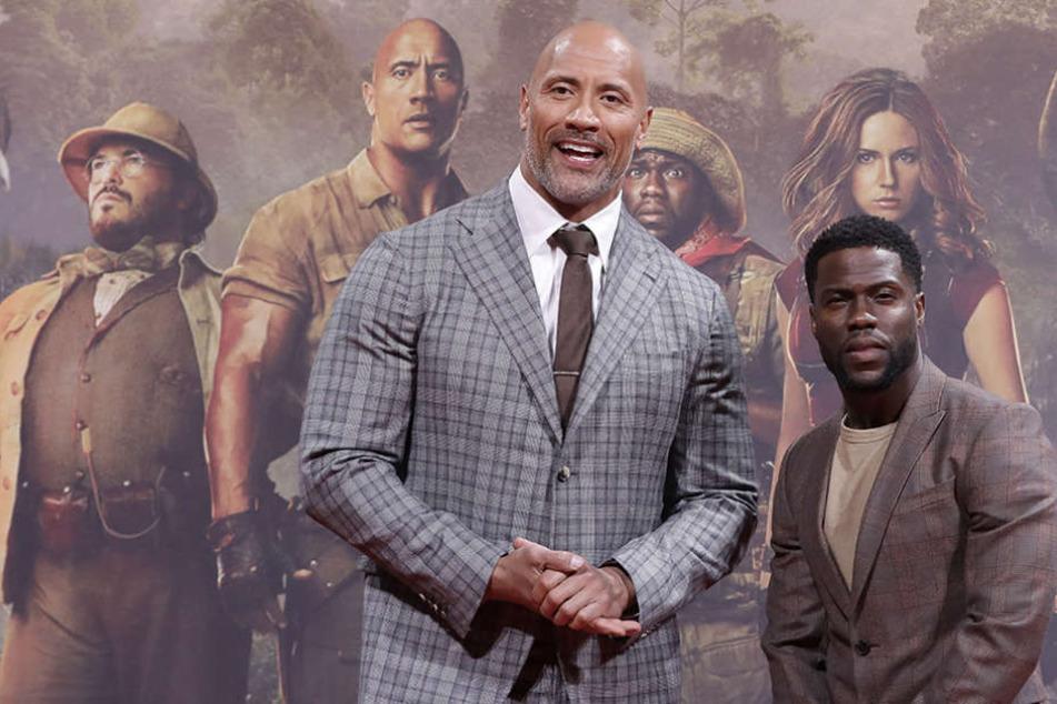 """Dwayne Johnson (l) und Kevin Hart bei der Deutschland-Premiere des Films """"Jumanji""""."""