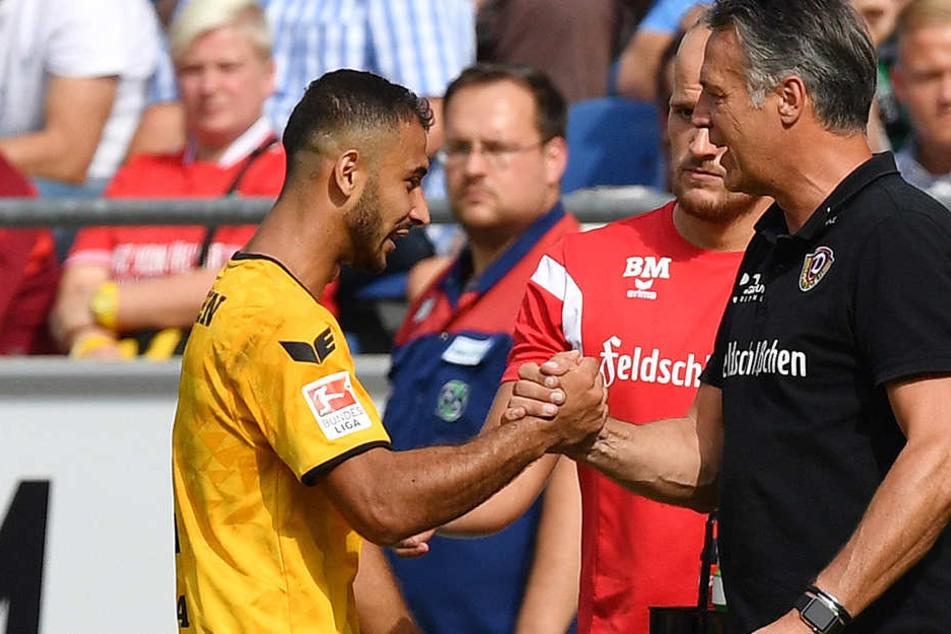 Akaki Gogia klatscht mit Dynamo-Trainer Neuhaus ab, der vor Braunschweig warnt.