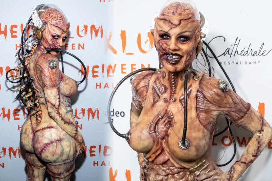 Heidi Klum (46) voller Blut und mit heraushängenden Organen. Soll das eine Art Cyborg sein?