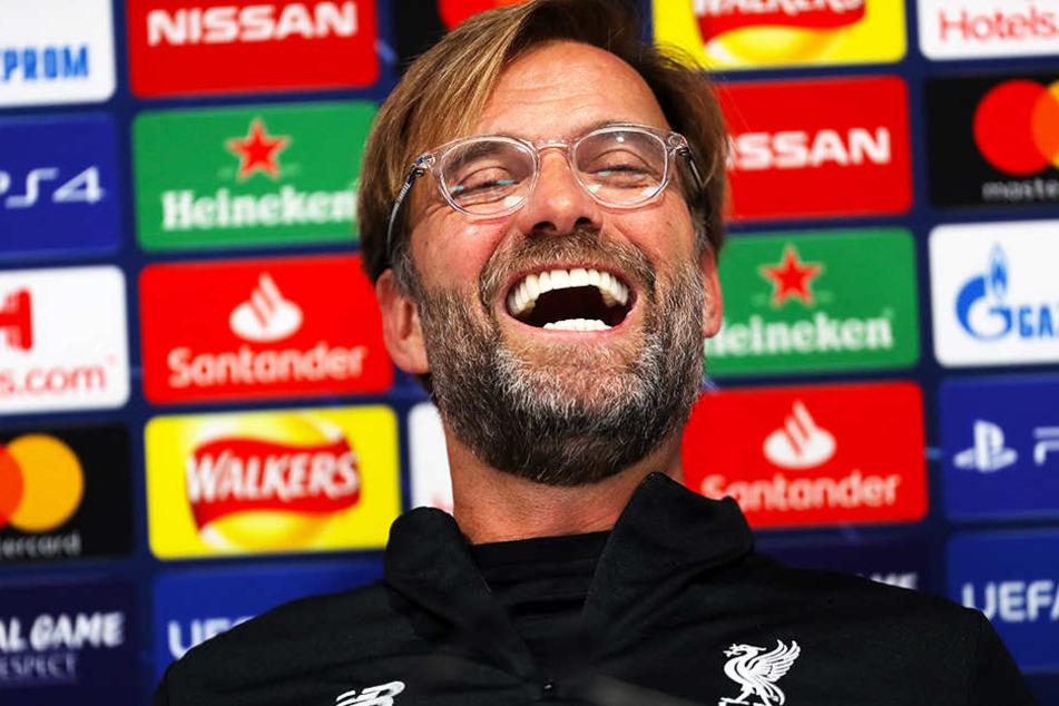 Da bleckt er seine strahlend weißen Zähne: Liverpool-Coach Jürgen Klopp machte Witze über die Entstehung einer möglichen Superliga.