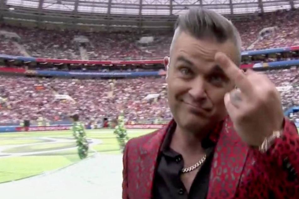 Faule Ausrede? So erklärt Robbie Williams seinen WM-Stinkefinger